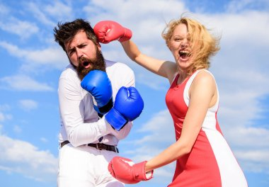 Attack is best defence. Couple in love fighting. Defend your opinion in confrontation. Female attack. Relations family life as everyday struggle. Man and woman fight boxing gloves sky background. stock vector