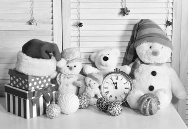 Toys placed on bureau on wooden wall background