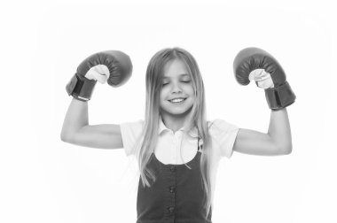 Winner takes it all Child ambitious likes win and success. Girl on smiling face posing with boxing gloves as winner, isolated white background. Kid long hair celebrates victory. Girls power concept