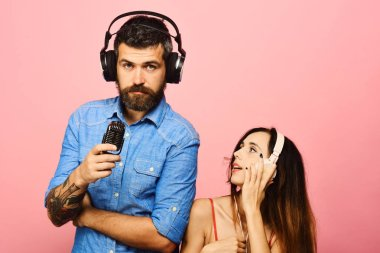 Technologies and music concept. Guy and lady with relaxed faces