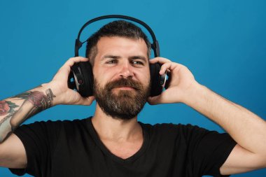 Singer with beard and smiling face enjoys music.