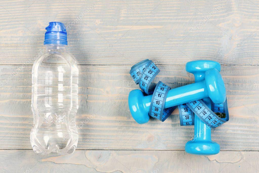 Centimeter tied around sports equipment in cyan blue