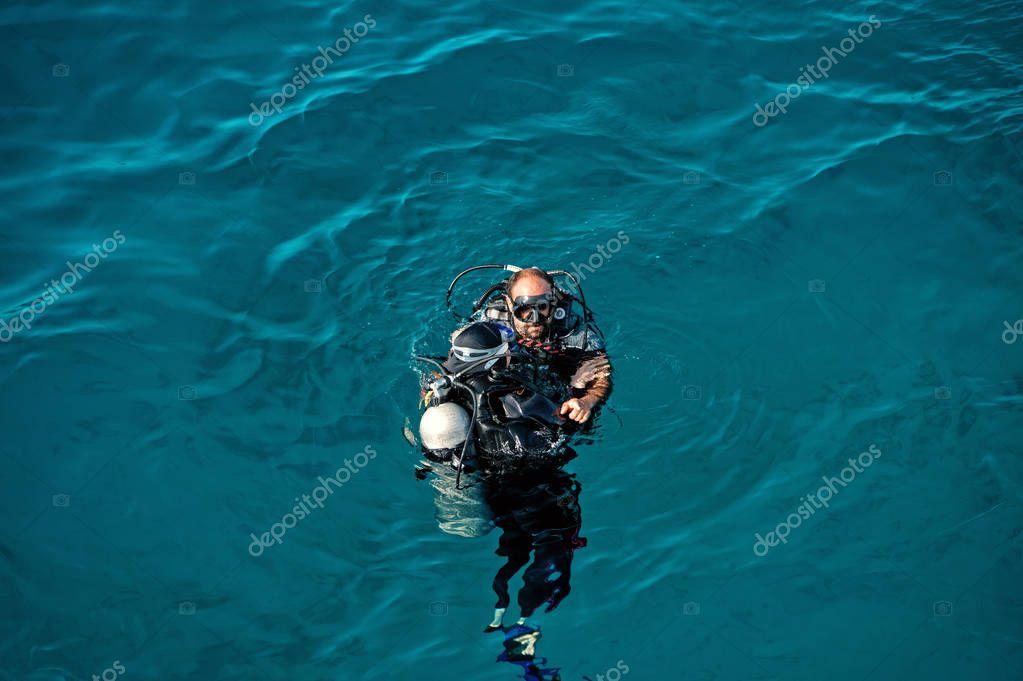 Underwater snorkeling diver, man in sea of Hurghada, Egypt