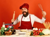 Fotografie Chef cook in commercial kitchen. Professional chef holds rolling pin
