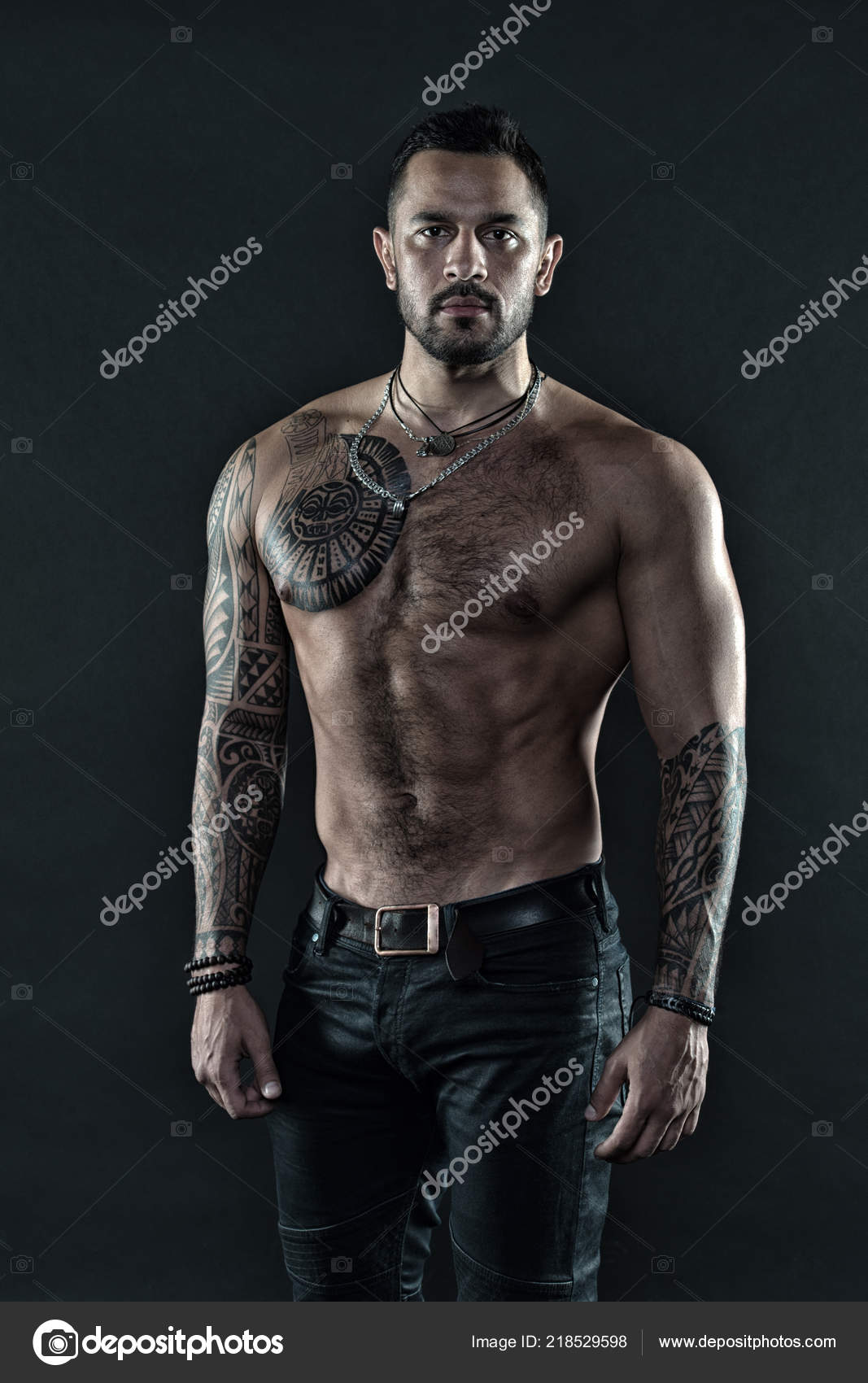 8ac073fad Tattoo art. Handsome fit man posing wearing in jeans with tattoo. Man  handsome shirtless muscular with ...