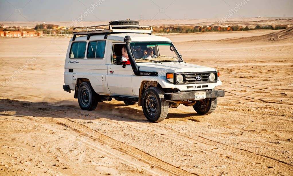 White toyota car driving in desert of Hurghada, Egypt