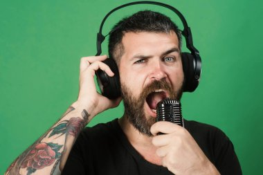 Relax and music concept. Man sings on green background.