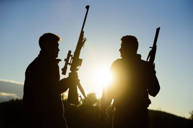 Hunter friend enjoy leisure. Hunters friends gamekeepers with guns silhouette sky background. Hunters rifles nature environment. Hunting with partner provide greater measure safety fun and rewarding