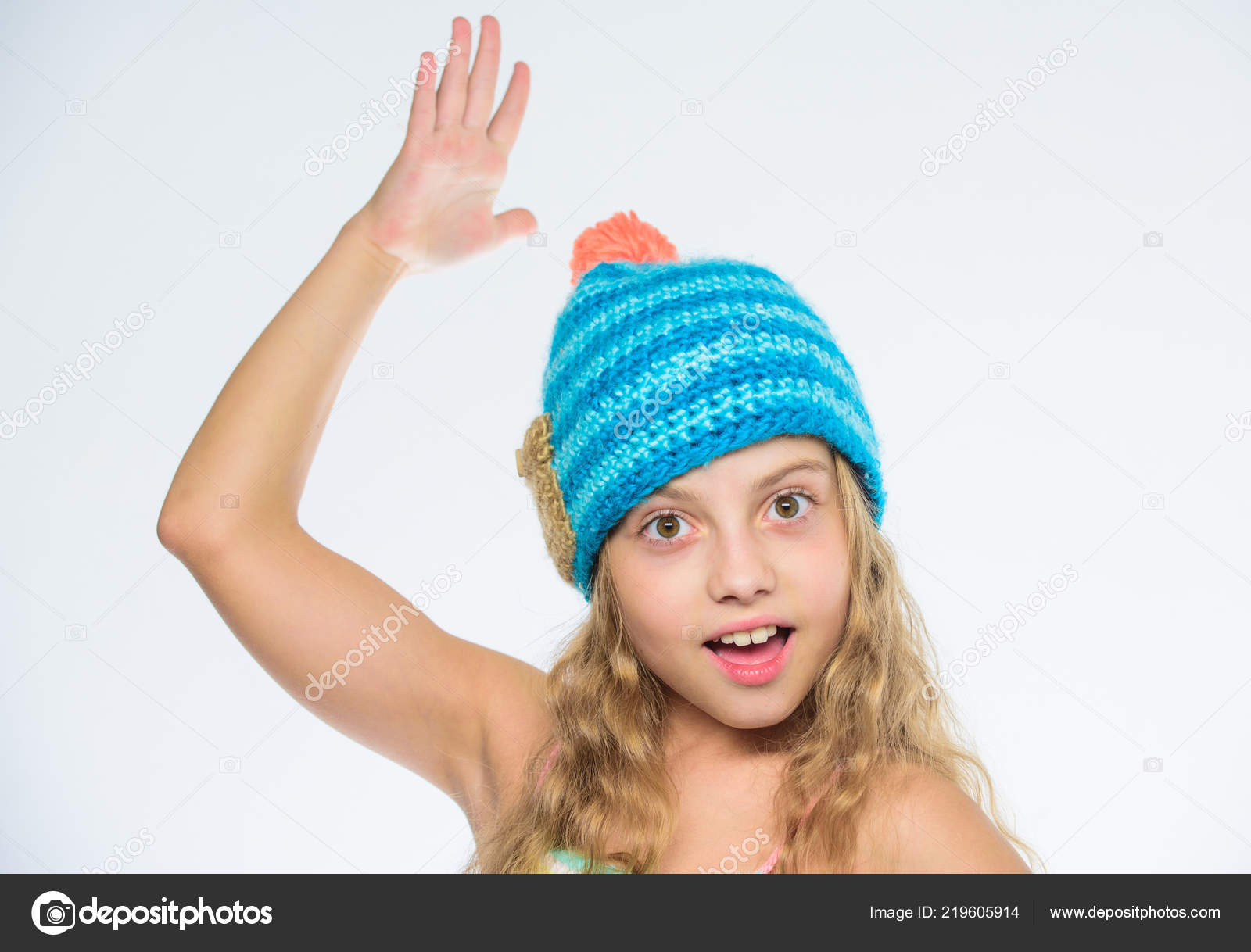c7792885d497 Free knitting patterns. Knitted hat with pompon. Girl long hair happy face  white background. Kid wear ...