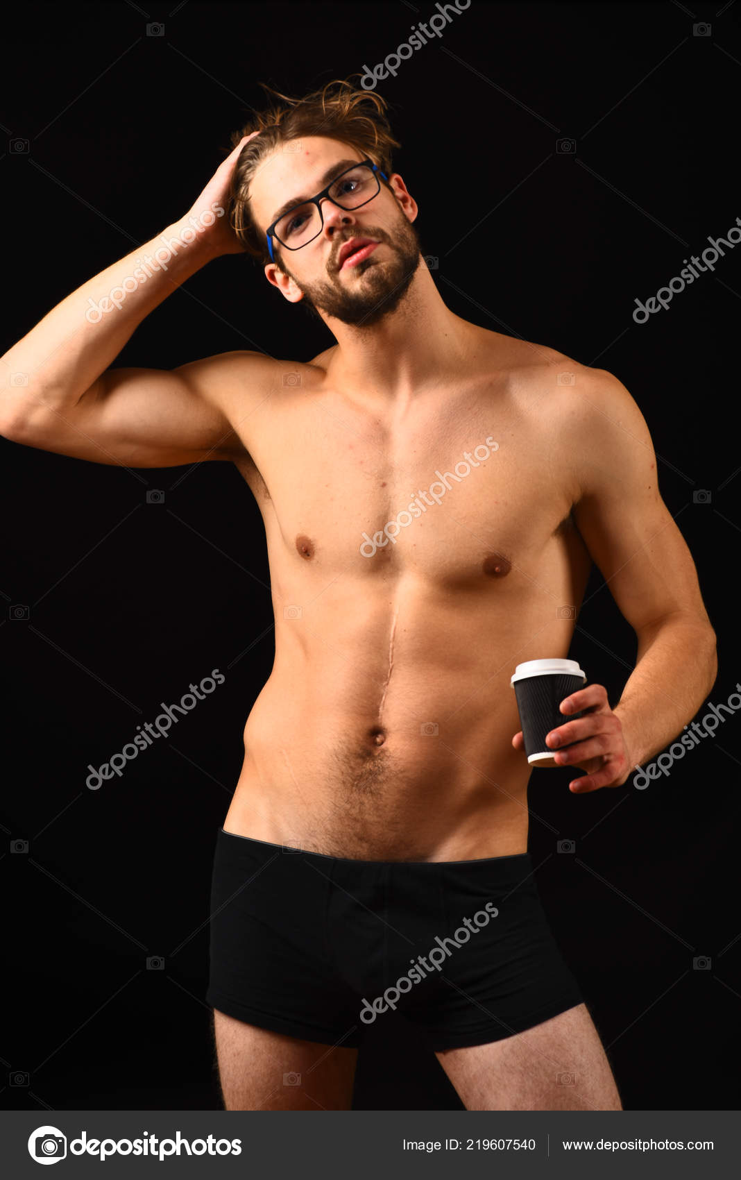 Macho attractive nude guy hold hot coffee. Bring her morning pleasure. Man  smart and sexy with beard and tousled hair wears eyeglasses.