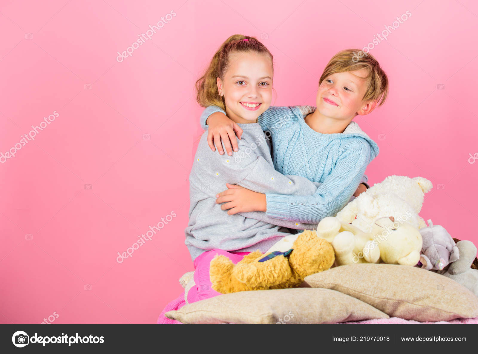 Friendship concept best friends brother and sister kids siblings friends hug pink background children friends near