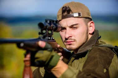 Hunting weapon gun or rifle. Man hunter aiming rifle nature background. Hunting skills and weapon equipment. Hunting target. Looking at target through sniper scope. Guy hunting nature environment