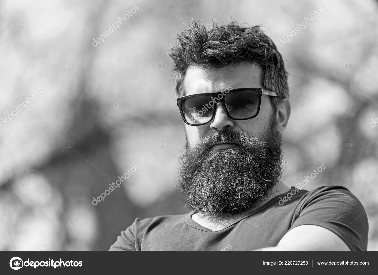cb2d94cfb04 Bearded guy wears stylish sunglasses. Man with beard looks stylish and  confident on sunny day. Fashion and style concept.