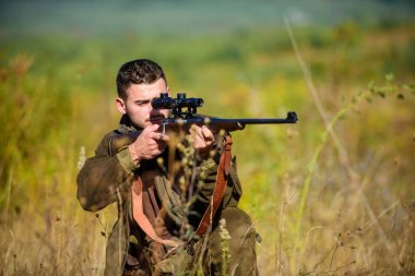 Guy hunting nature environment. Hunting weapon gun or rifle. Hunting target. Masculine hobby activity. Experience and practice lends success hunting. Man hunter aiming rifle nature background