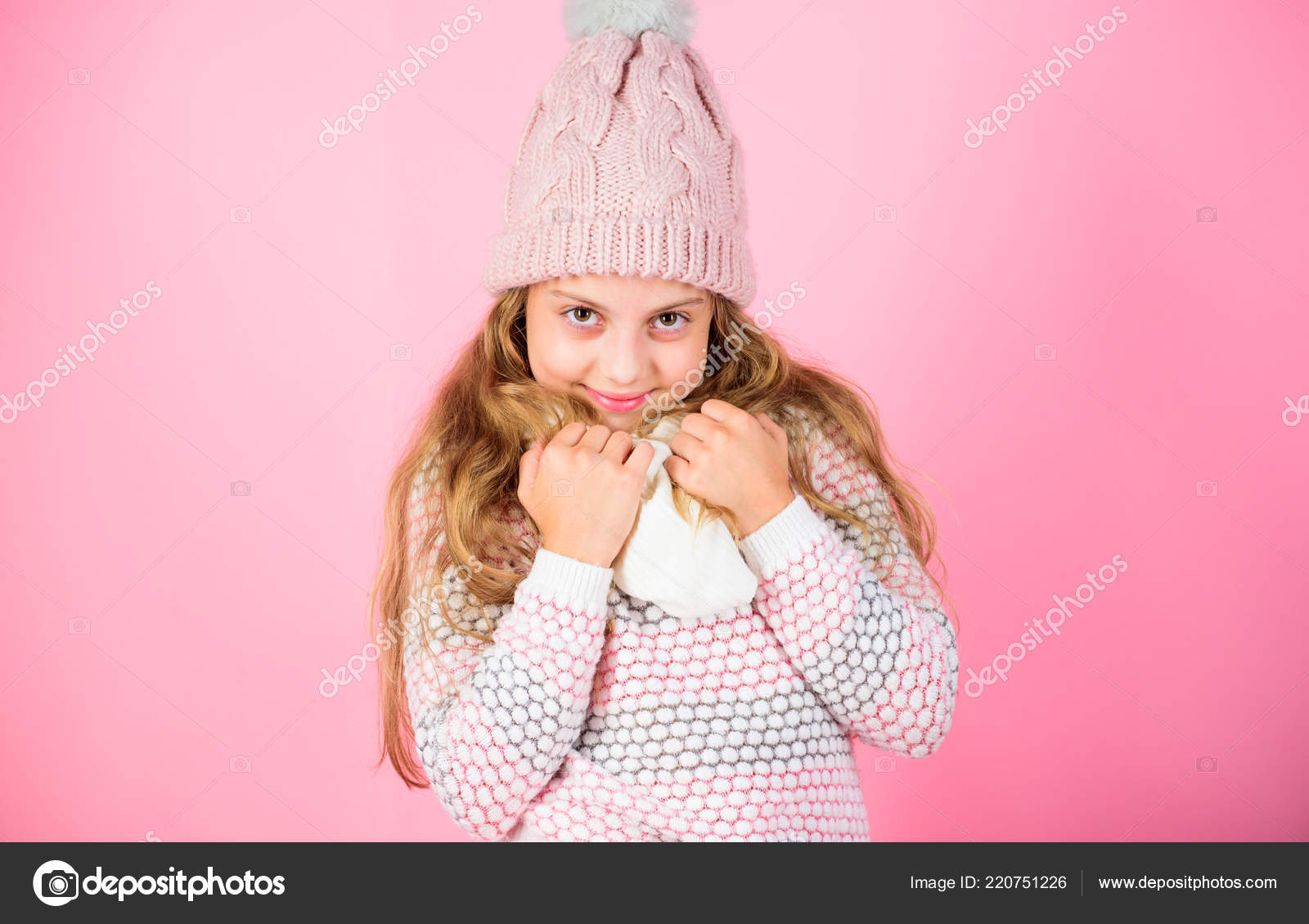 df6ba9b90 Girl long hair dreamy mood pink background. Kid smiling wear knitted ...