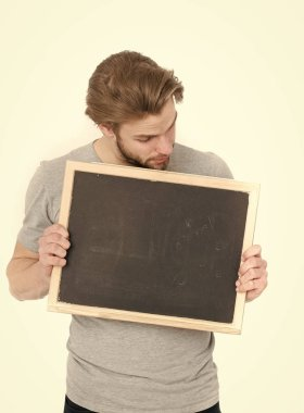 surprised handsome man holding blackboard isolated on white background