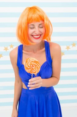 Crazy girl in playful mood. Cool girl with lollipop. Sexy woman. happy pinup model with lollipop. Fashion girl with orange hair having fun. Happiness and carelessness. Enjoy party. So much fun