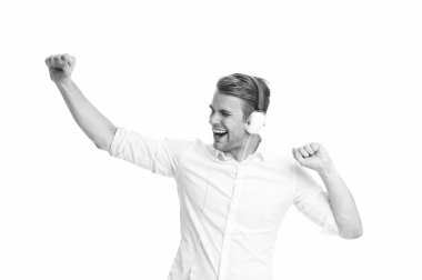 Dancing music. Man listening favourite song in headphones and dancing. Man happy face enjoy listening music radio isolated white background. Guy with earphones dancing while listening music