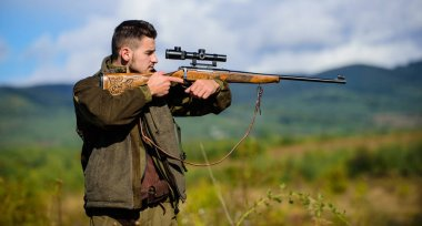 Guy hunting nature environment. Hunting weapon gun or rifle. Masculine hobby activity. Hunting target. Man hunter aiming rifle nature background. Experience and practice lends success hunting