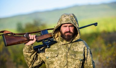Guy hunting nature environment. Bearded hunter rifle nature background. Hunting big game typically requires tag each animal harvested. Experience and practice lends success hunting. Hunting season
