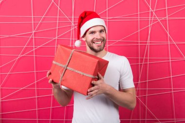 delivery christmas gifts. The morning before Xmas. man in santa hat hold christmas present. online christmas shopping. Happy new year. happy santa man. Merry Christmas. i am so happy. Dear santa