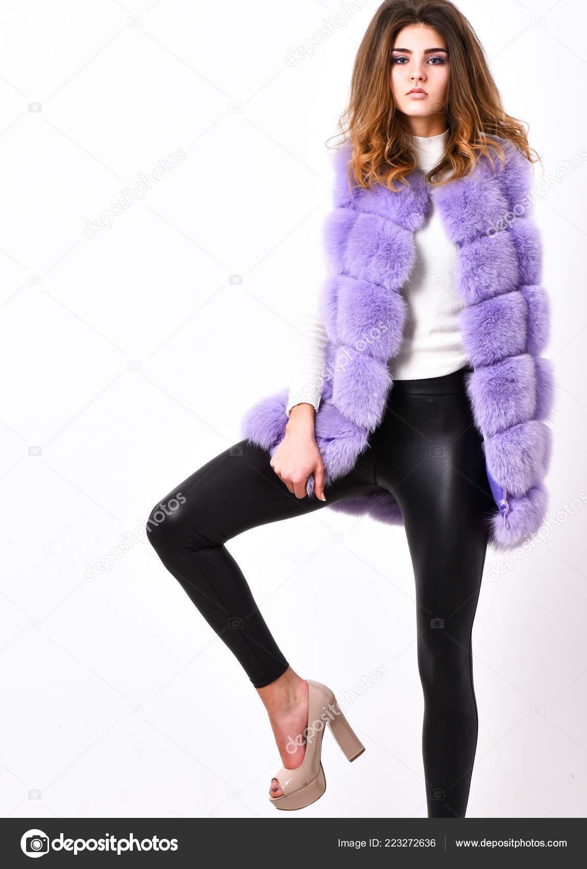 0fce76f143ccd8 Fashion trend concept. Winter fashionable wardrobe for female. Boutique  selling fur. Violet fur vest fashion clothing.