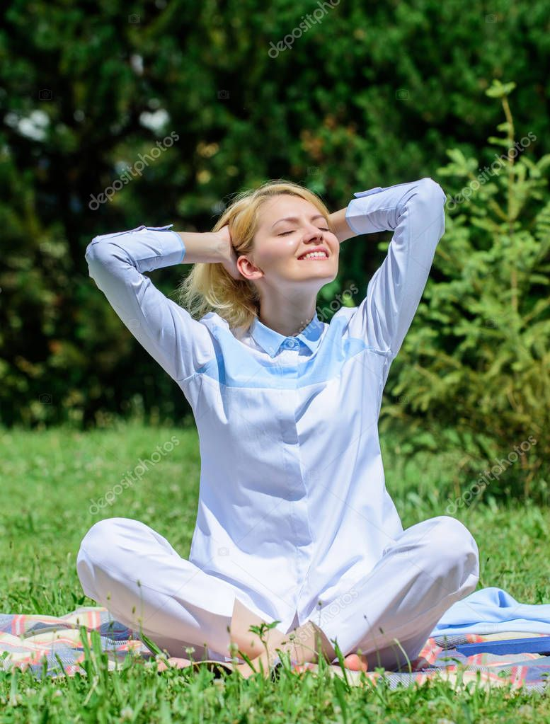 Every day meditation. Reasons you should meditate every day. Clear your mind. Girl meditate on rug green grass meadow nature background. Find minute to relax. Woman relaxing practicing meditation