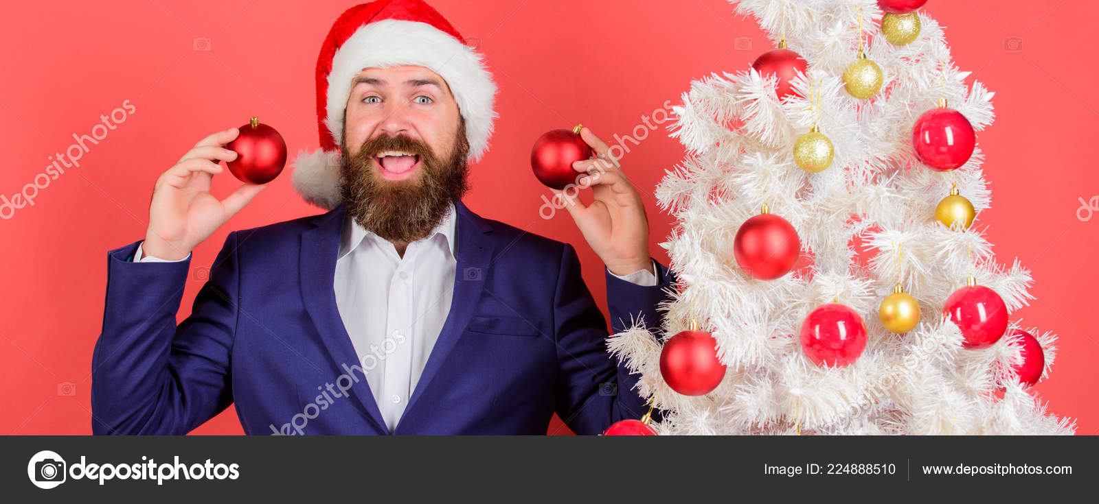 5c3cb2683cafe Merry christmas. Christmas atmosphere spread around. Add magic to holidays.  Man bearded wear formal suit and santa hat– stock image