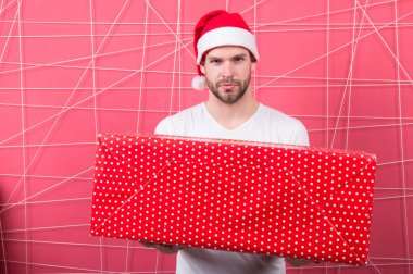 The morning before Xmas. delivery christmas gifts. man enjoy the holiday. man in santa hat hold christmas present. Merry Christmas and Happy Holidays. Bright memories