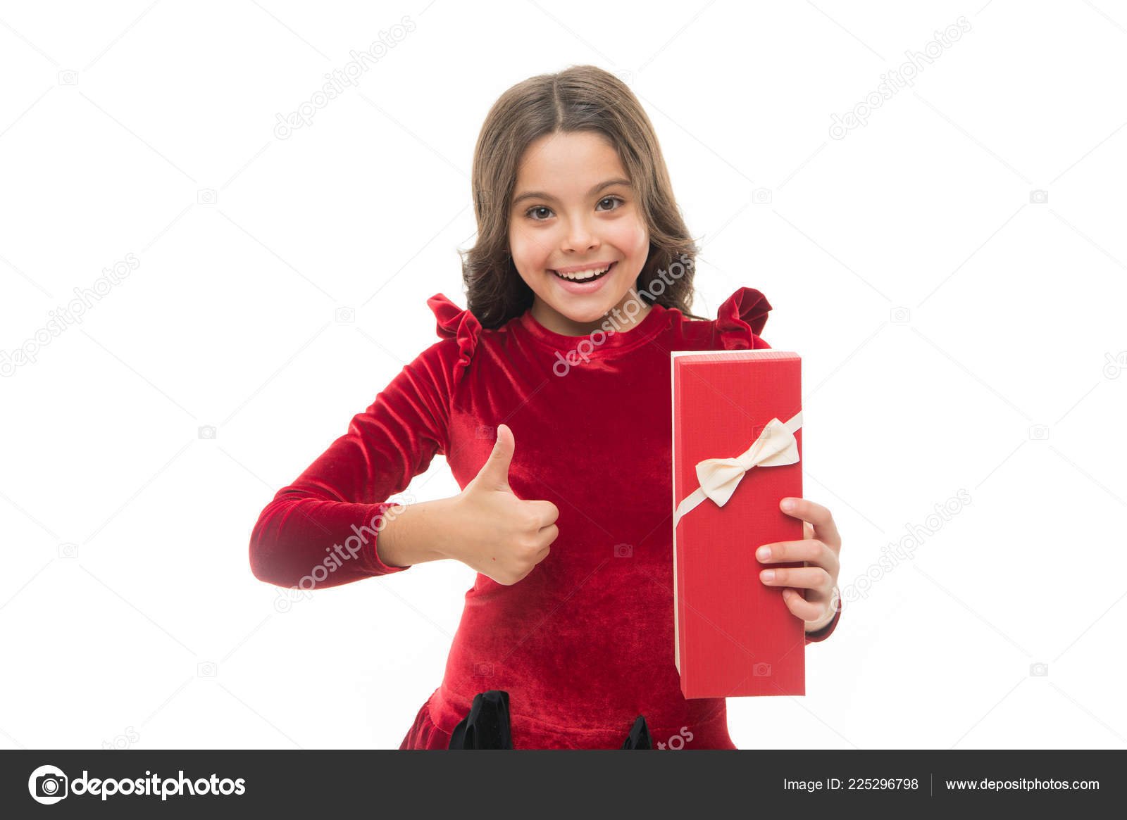 enjoy receiving presents best toys and christmas gifts for kids kid little girl in dress curly hairstyle hold gift box child excited about unpacking her