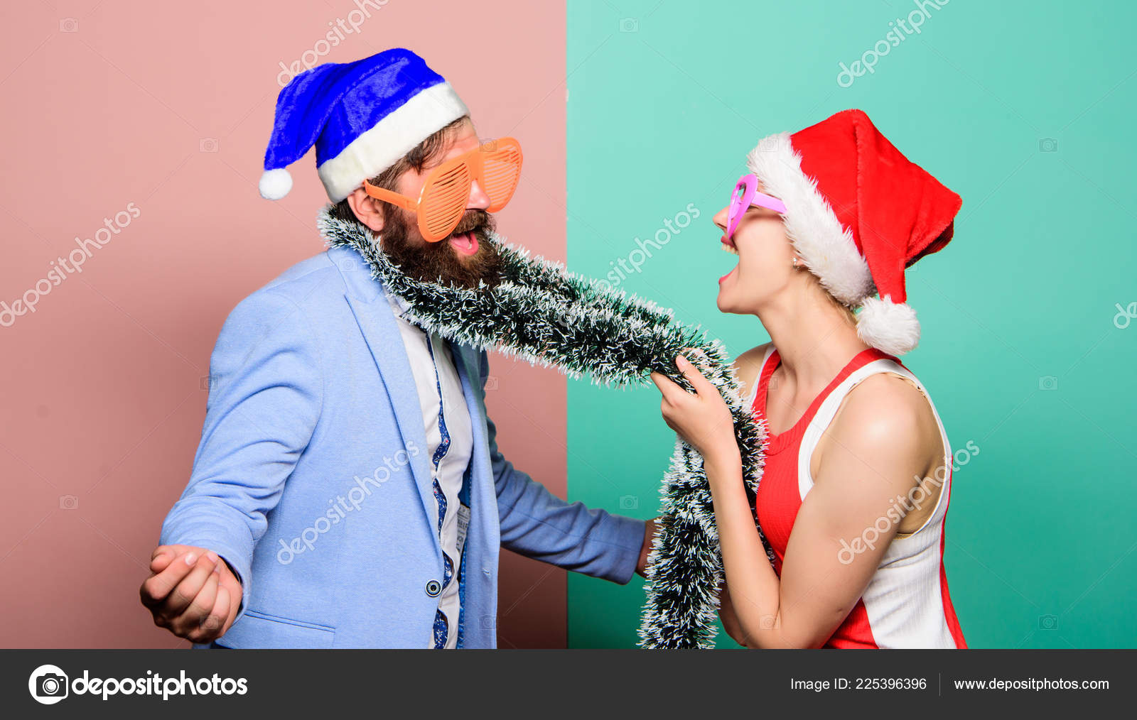 merry christmas and happy new year family celebrating christmas new year party happy couple in santa claus hat christmas shopping gifts all i want for