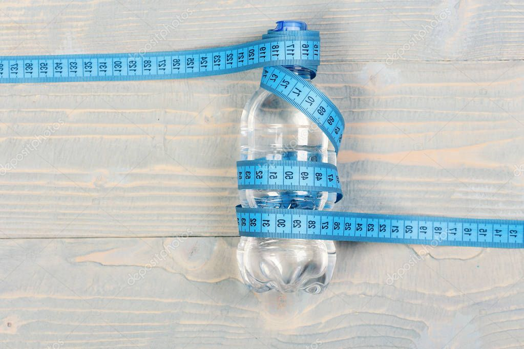Water and measuring tape. Tools for healthy and active lifestyle