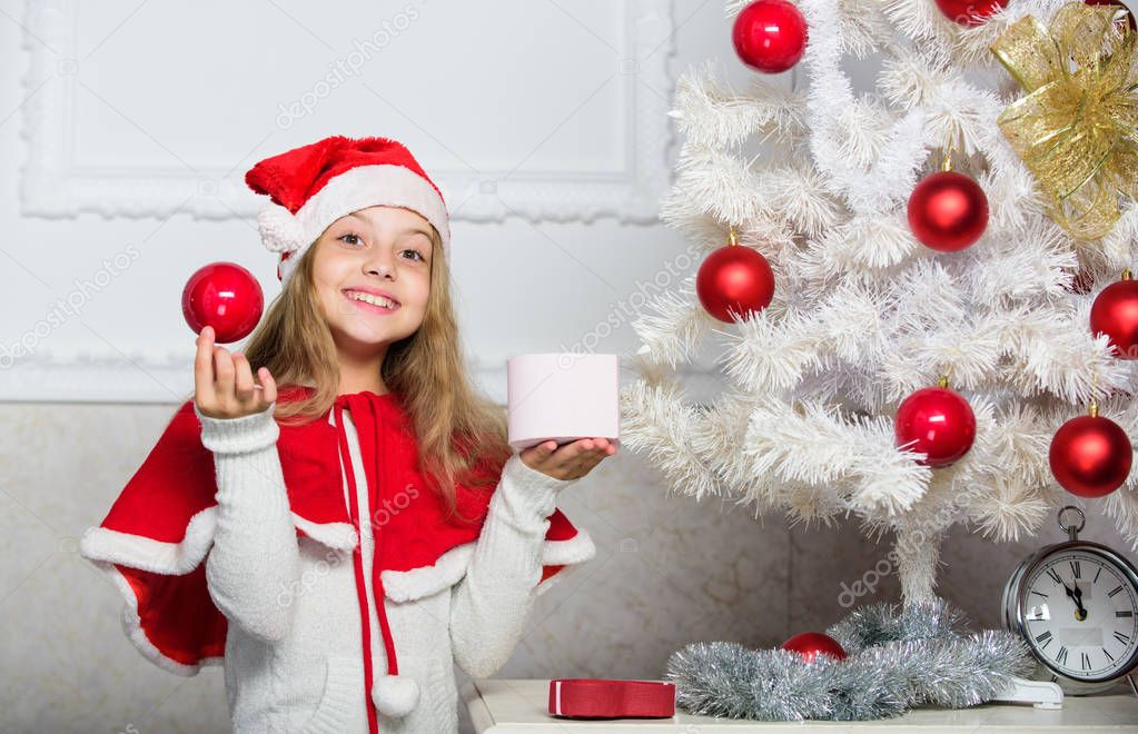 Unpacking christmas gift. Happy childhood concept. Winter holiday tradition. Kid with christmas present. Reason children love christmas. Girl celebrate christmas open gift box. Santa bring her gift