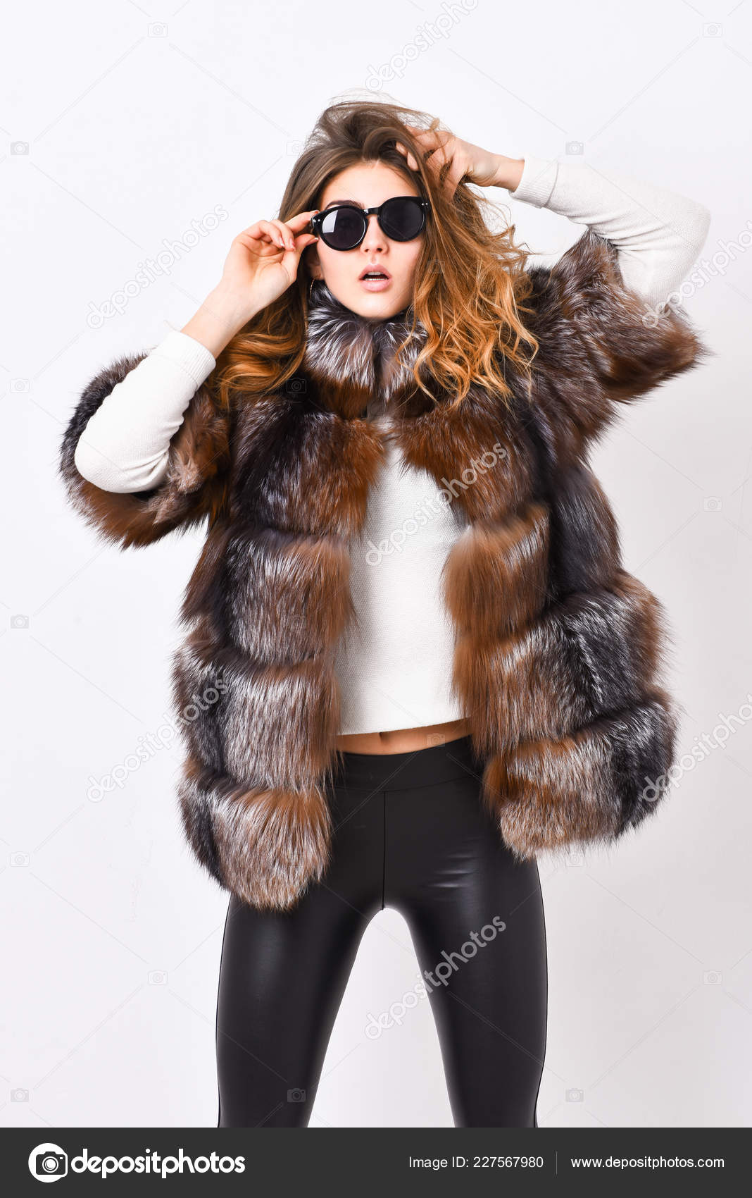 1a11b950107 Woman wear sunglasses and hairstyle posing mink or sable fur coat. Fur  fashion concept. Winter elite luxury clothes. Female brown fur coat. Fur  store model ...