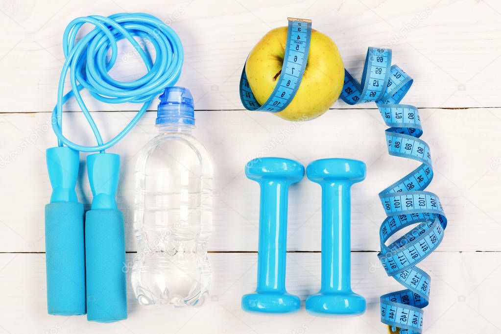Sports equipment in cyan blue on white background