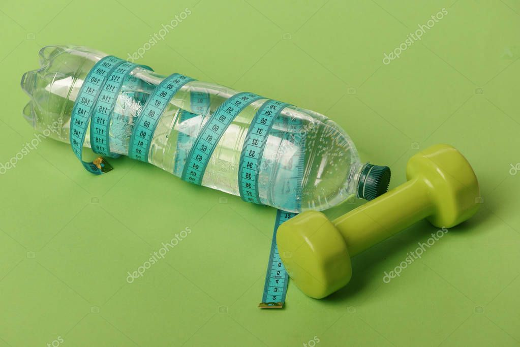 Sports and healthy regime equipment. Dumbbells in green color