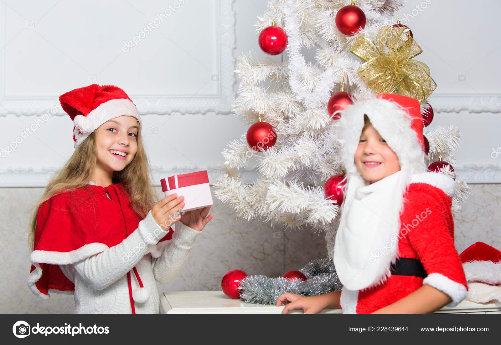 Unpacking christmas gifts. Merry christmas. Boy kid dressed as santa with white artificial beard and red ...  sc 1 st  Depositphotos & Unpacking christmas gifts. Merry christmas. Boy kid dressed as santa ...