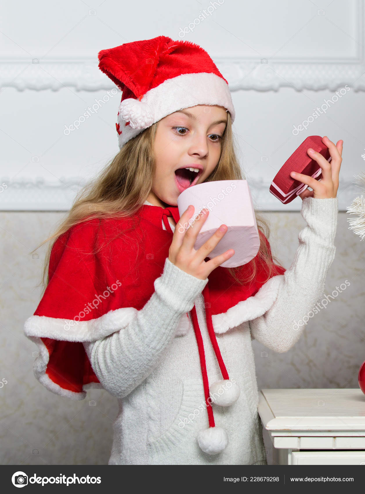 Reason children love christmas. Girl celebrate christmas open gift ...