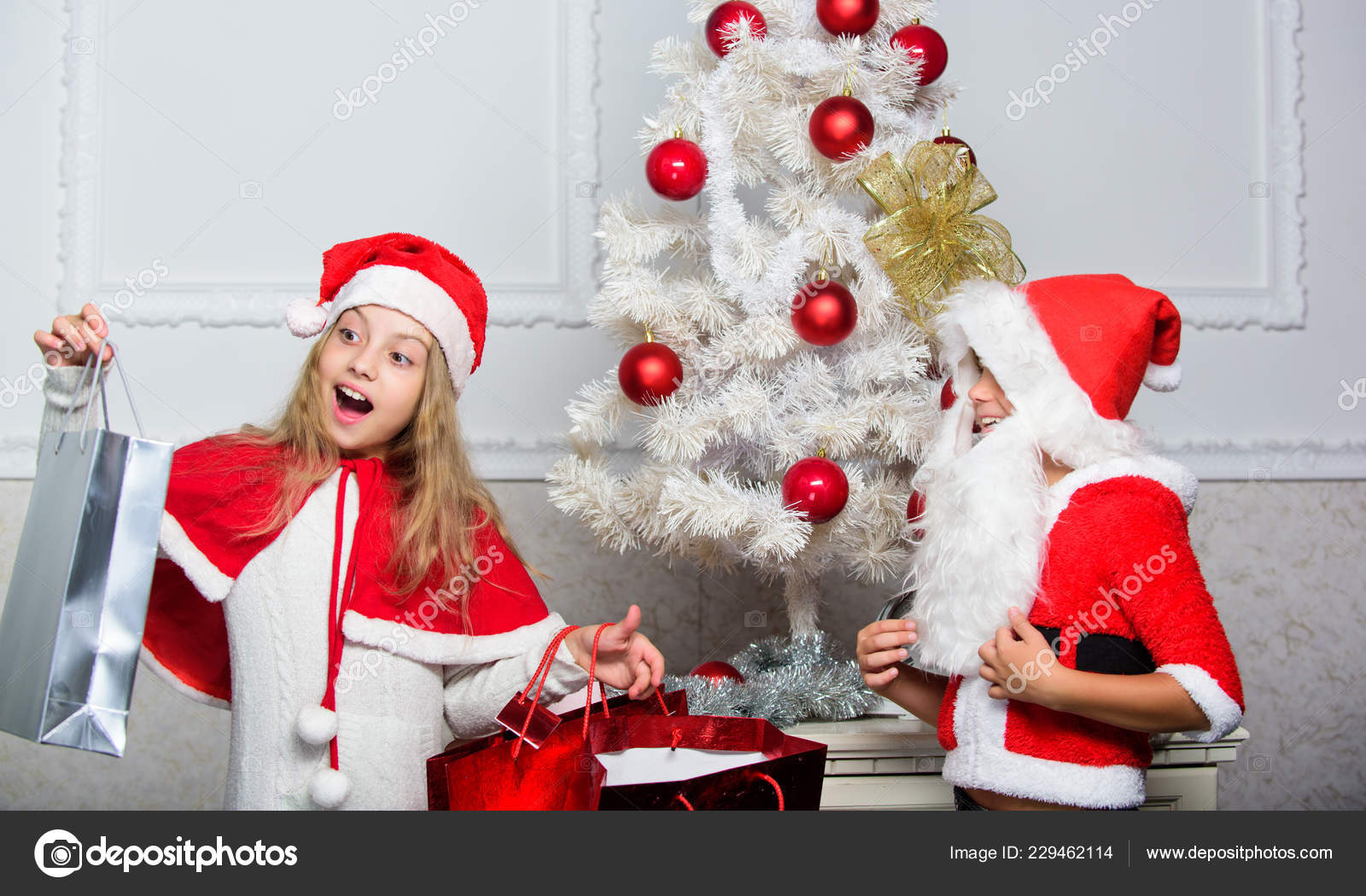 Kids celebrate christmas with gifts. Boy kid santa with white ...