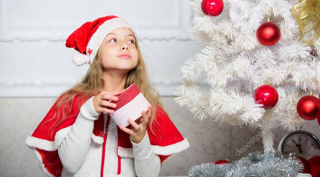 Winter holiday tradition. Kid with christmas present. Reason children love christmas. Girl celebrate christmas open gift box. Santa bring her gift. Unpacking christmas gift. Guess what inside box