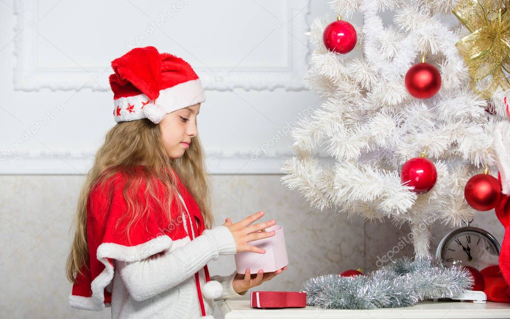 Happy celebration concept. Winter holiday tradition. Kid with christmas present. Reason children love christmas. Girl celebrate christmas open gift box. Santa bring her gift. Unpacking christmas gift.