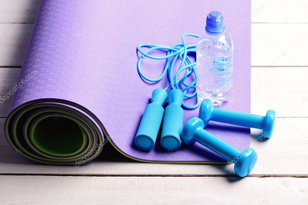 Dumbbells and jump rope in cyan blue color