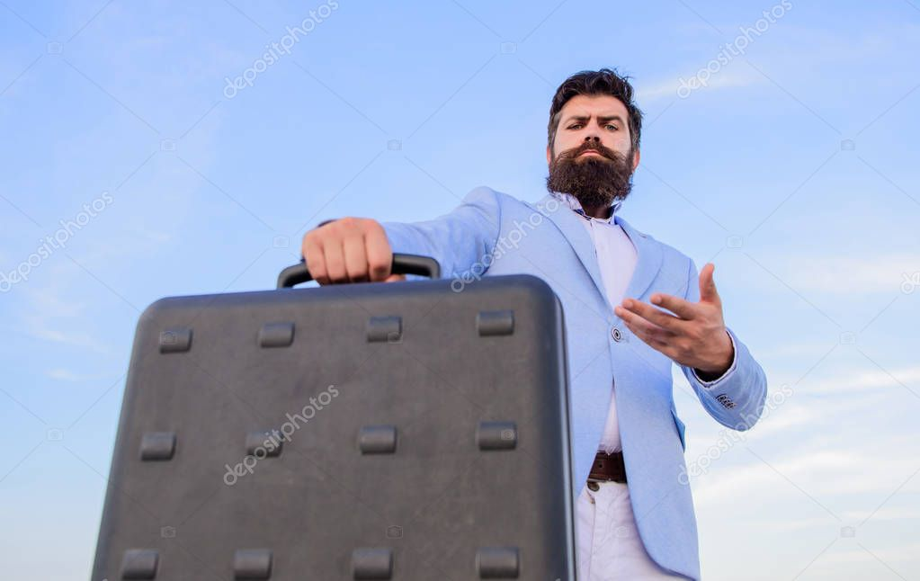 Illegal deal business. Hipster bearded face hold briefcase with bribe. Business man formal suit carries briefcase sky background. Businessman presenting business case. Entrepreneur offer bribe.