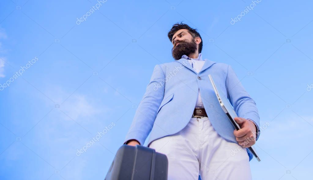Illegal deal business. Businessman presenting business case. Business man formal suit carries briefcase sky background. Entrepreneur offer bribe. Hipster bearded face hold briefcase with bribe