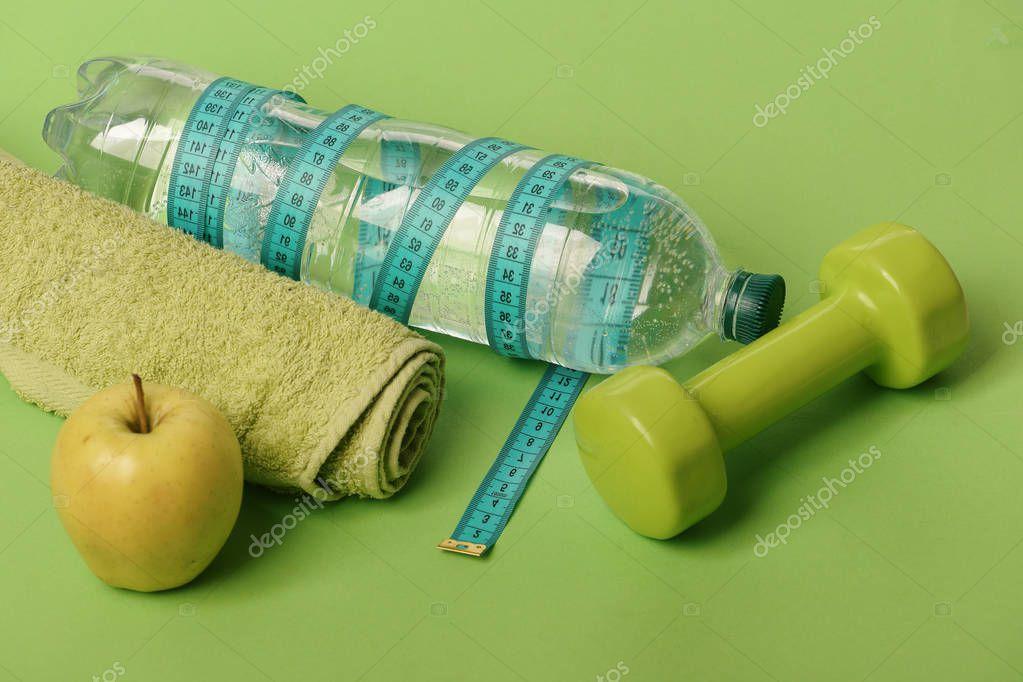 Healthy regime equipment, copy space. Barbell by juicy green apple