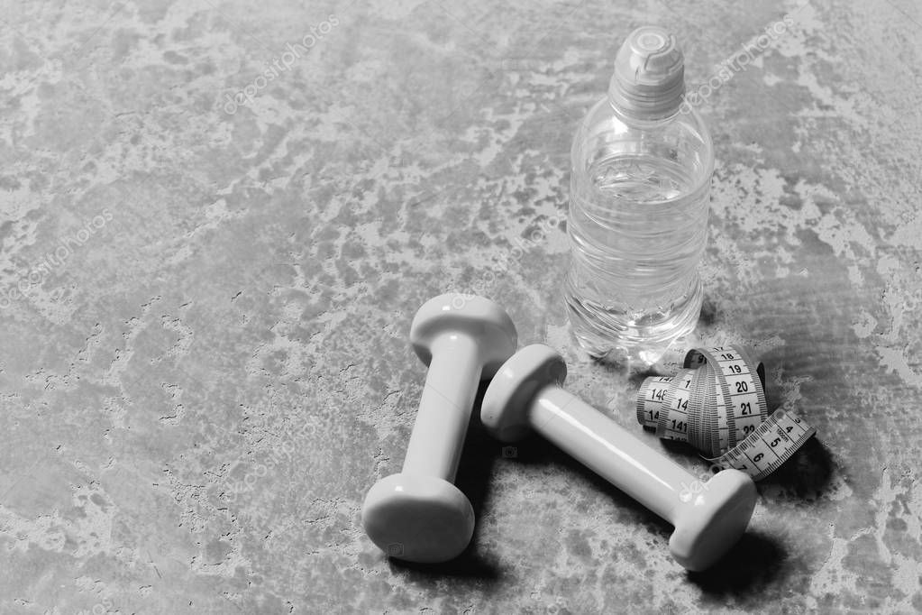 Sports and healthy training idea. Water and measuring tape