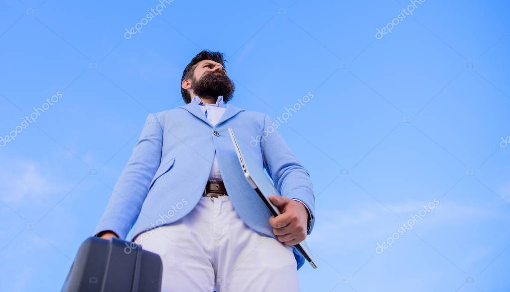 Entrepreneur offer bribe. Illegal deal business. Hipster bearded face hold briefcase with bribe. Businessman presenting business case. Business man formal suit carries briefcase sky background