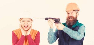 Builder, repairman makes hole in female head.