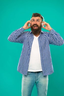 Best gifts for music lovers. Bearded hipster wear headphones. Excellent sound. Music library concept. Tech gadgets all music lovers should have. Music always with me. Man listening song in headphones