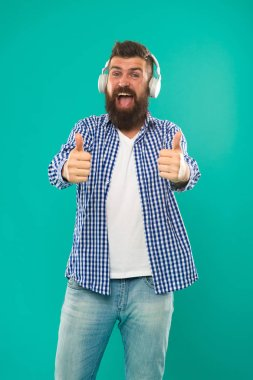 Excellent sound. Music library concept. Tech gadgets all music lovers should have. Music always with me. Man listening song in headphones. Best gifts for music lovers. Bearded hipster wear headphones
